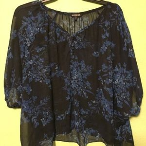Black and blue floral blouse, loose fitting.
